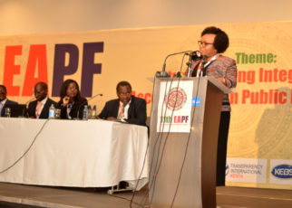 The Chief Administrative Secretary at the National Treasury, Nelson Gaichuhie reads the opening speech on behalf of CS Henry Rotich at the 11th East African Procurement Forum in Nairobi. Looking on is Sylvia Aluoch, an Advisor at GIZ while others are Faith Waigwa, the Chairperson of the Public Procurement Administrative Review Board (PPARB) on the extreme left and Andrew Musangi, the Chairperson of the Public Procurement Regulatory Board.