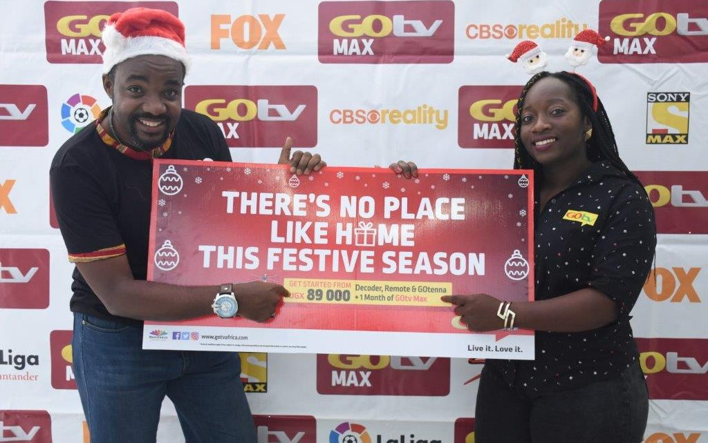 L-R: Albert Nga (L) GOtv Marketing Manager and Tina Wamala (R) PR and Communications Manager unveil the new bundled offer for GOtv subscribers this festive season 2018 ,the announcement was made today at MultiChoice Uganda offices in Kololo, Kampala