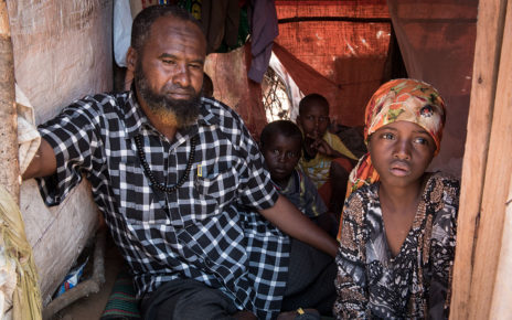 Abdi Yussuf, 47, lives in a Mogadishu camp for displaced families with his five children.