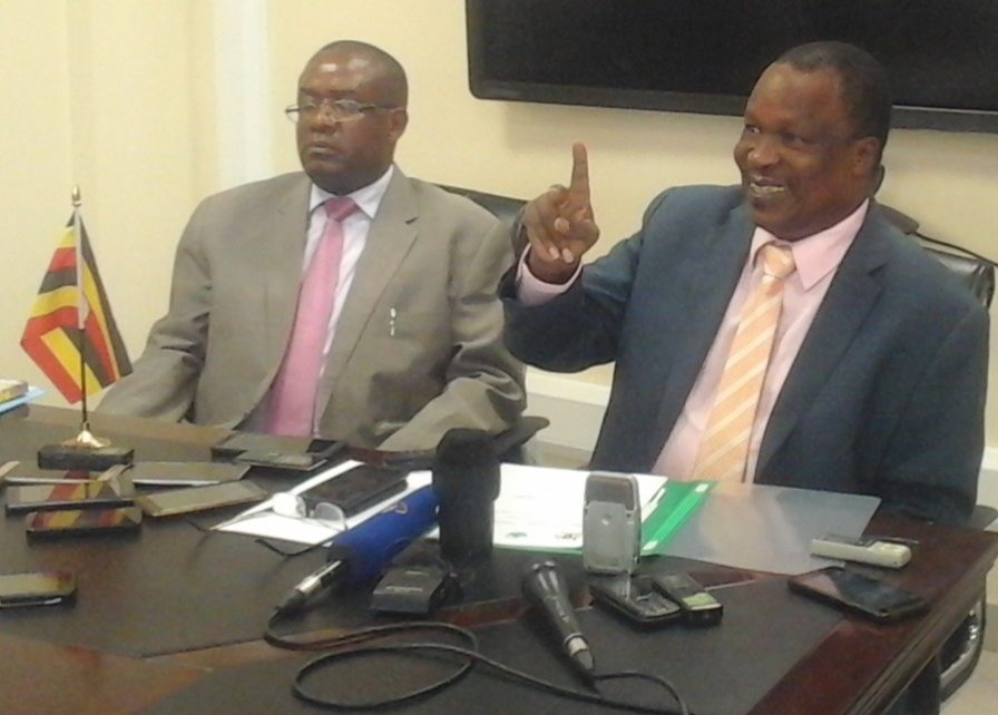 Water and environment Minister Sam Cheptoris (right) addressing the press in Kampala early in the week