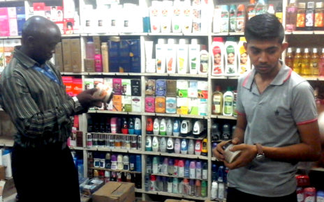 UNBS Officer checking the cosmetics in one of the Shop