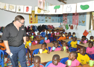 Plascon' s Retail Marketing Manager Mr. Tyron Immelman interacts with pupils of Mother Ludia Nursery school in their newly painted classroom