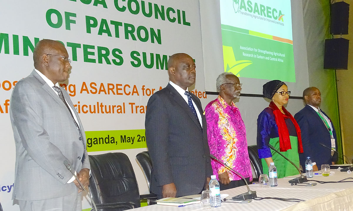 Uganda' s minister of Agriculture Animal Industry and Fisheries Vincent Bamulangaki Ssempijja (2nd left) and second Deputy Prime Minister, also Minister for East African Community Affairs Kirunda Kivenjinja (3rd left), join other participants during the Association of Strengthening Agricultural Research in East and Central Africa (ASARECA) Council of Patron Ministers conference in Munyonyo last week.
