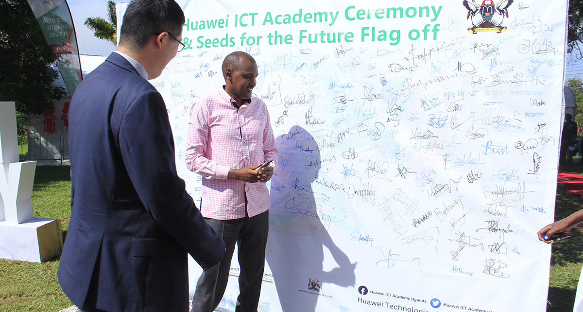 The ICT Minister Hon Frank Tumwebaze making an autograph at the ICT Academy Ceremony