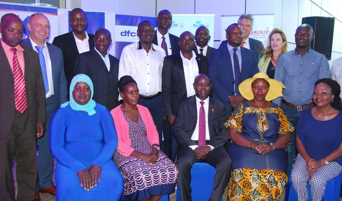 Pius Wakabi, the Permanent Secretary Ministry of Agriculture (centre) in a group picture with some of the farmers